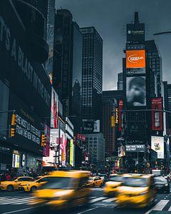 Racende Taxi's op Times Square New York van Yannick Karnas