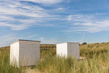 Strandhuisjes tussen het helmgras van Percy's fotografie
