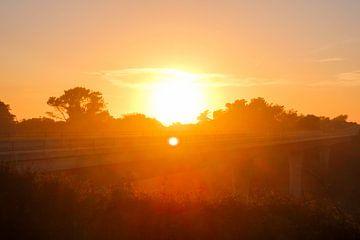 Zonsondergang snelweg 1 van Florian Kampes