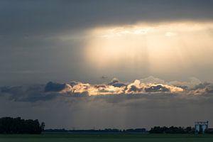 Zonnestralen en Wolken van
