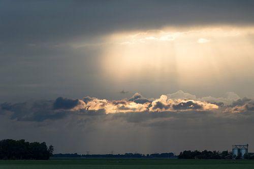 Zonnestralen en Wolken