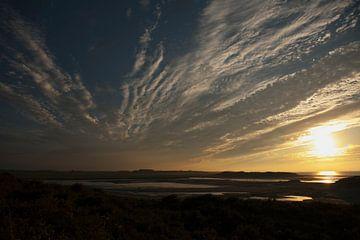 Sunset on the beach van Marco van der Veldt
