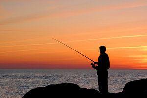 Angler in sunset light