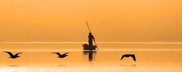 Visser bij zonsopkomst von Antwan Janssen