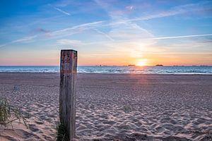 Zonsondergang op het strand bij Wassenaar van Arthur Scheltes