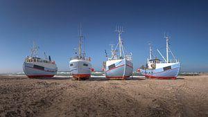 Bateaux de pêche sur la plage au Danemark Thorup Strand