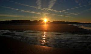 Zon komt op bij het strand van Zoutelande