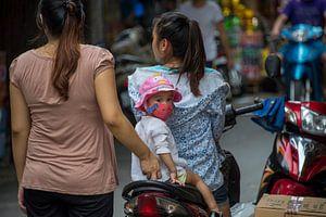 Kind op scooter