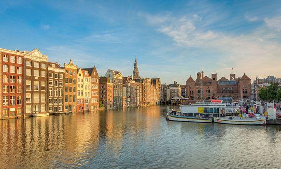 Amsterdam Damrak in the evening sun
