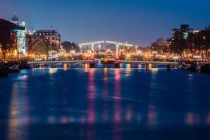 Magere Brug, Amsterdam bij avond van