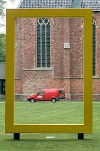 Groningen / Ter Apel / Rode bestelauto in geel National Geographic frame / 2011