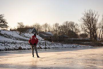 Eenzame schaatser op het ijs