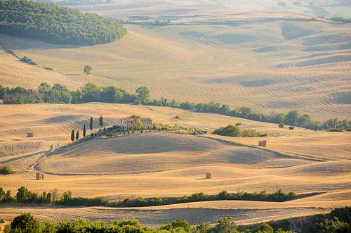 Tuscany farm on a hill van