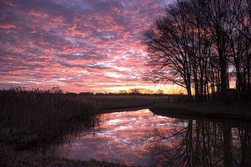 Reflectie zonsopkomst van Kelly Berghuis