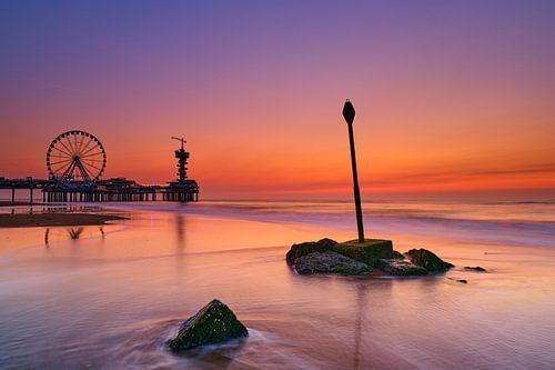 Scheveningse strand na zonsondergang