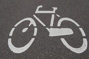 Logo fiets op asfalt