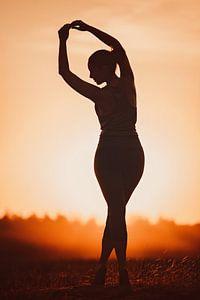 Yoga tijdens ondergaande zon