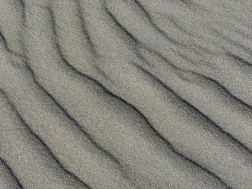Waterstempel op strand van