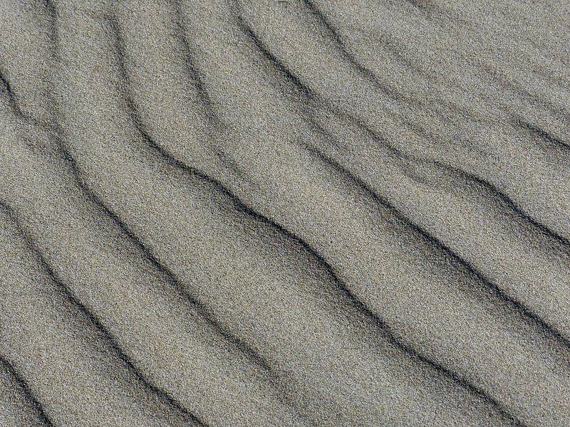 Waterstempel op strand van Angelique Roelofs