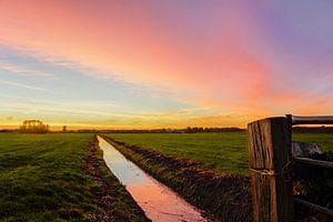 Zonsopkomst in de polder van Hanno de Vries
