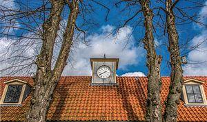 Dak en klok van het gerestaureerde Veenhuizen in Drenthe