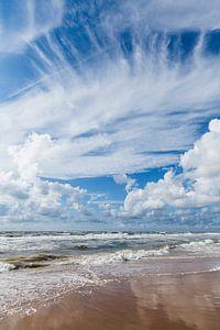 North Sea beach at Castricum, Bakkum aan Zee. reflective cloudy sky