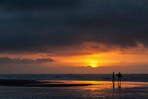 Surfers - zonsondergang van