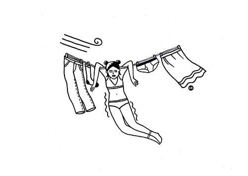 Meisje aan de waslijn