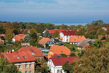Buildings with blue sky in Wustrow, Germany van Rico Ködder