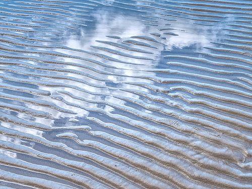 Ontmoeting van drie elementen: water, aarde, lucht van