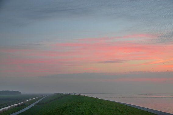 Zonsondergang bij waddenzee