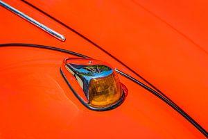 Richting aanwijzer van een rode Volkwagen