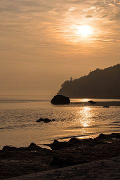 Sunrise on shore of the Baltic Sea van Rico Ködder