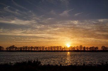 sun going down van Roland Smanski