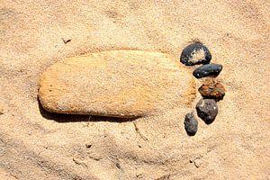 Voet in het zand