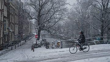 Amsterdam Radfahrer im Schnee von