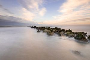 Pastelkleurige zonsondergang aan het strand van Texel van Onno Wildschut