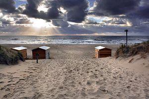 Ondergaande zon strandhuisjes Texel