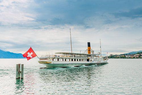The steam ship La Suisse set sails from Montreux port (Switzerland), by the Leman lake. van