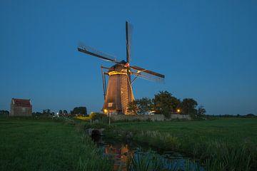 Verlichte molens Kinderdijk #1 van John Ouwens