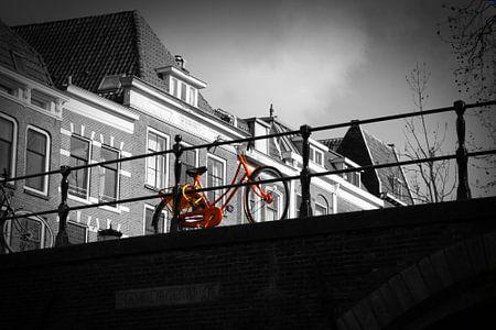 Orange Bike on bridge