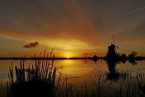 Kleurrijke zonsopkomst in een Hollands landschap van G. de Wit