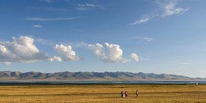 Kids playing on the shores of Song Kol Lake