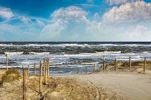 Pad door de duinen naar het strand