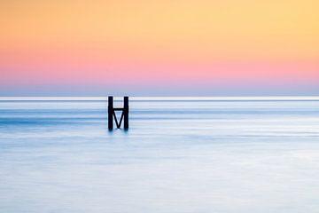 Het havenhoofd van Westkapelle tijdens zonsondergang van