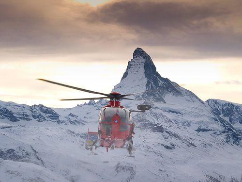 Rescue Helicopter of Air Zermatt in front of the Matterhorn