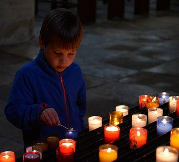 Lighting the candles. van Maren Oude Essink