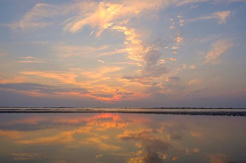 Sunset at the beach during summer with a calm sea