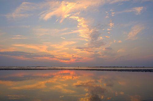 Sunset at the beach during summer with a calm sea van Sjoerd van der Wal