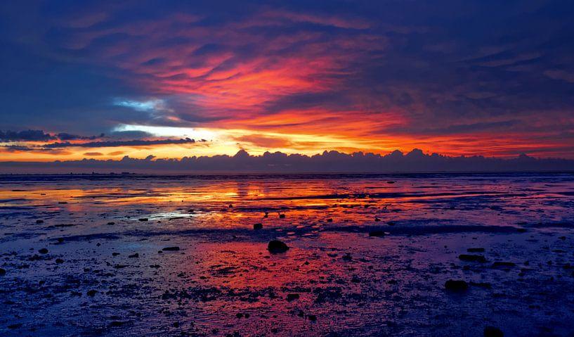 waddezee zonsondergang van rene schuiling